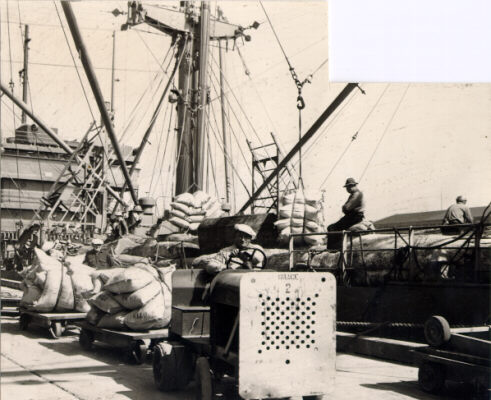 File:Wagons of coffee are hauled by a small dock truck April 20 1946 AAC-2158.jpg