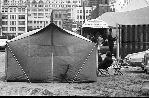 Tenants and Owners in Opposition to Redevelopment tent stands across the street from the San Francisco Convention & Visitors Bureau Annual Luncheon June 1971 TOR-0214.jpg