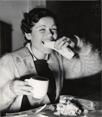 Aug 12 1937 Dolores Soper eating in a soup kitchen for striking 5 & 10 cent store workersAAD-5373.jpg