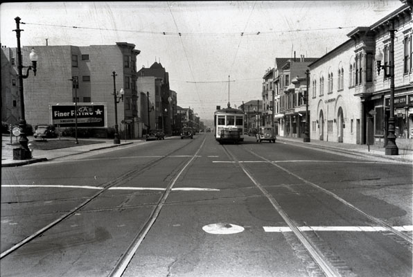 25th and Valencia streets looking south at southbound -9 line car and Southern Pacific crossing containing original cable car slot 1942 aax-0116.jpg